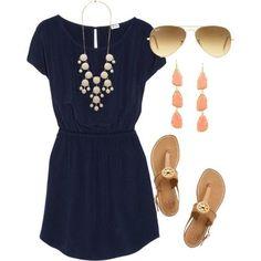 Navy dress, white bubble necklace, camel sandals.