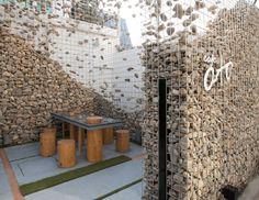 Love this... Gabion wall with floating stone. Cafe Ato Sinmunro in Seoul - Design by BONO Photo retaildesignblog.net