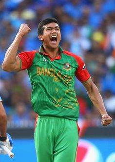 Taskin Ahmed of Bangladesh celebrates getting the wicket of Rohit Sharma of India during the 2015 ICC Cricket World Cup match between India and Bangldesh at Melbourne Cricket Ground on March 19, 2015 in Melbourne, Australia.