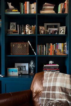 Dark blue bookcase and leather chair