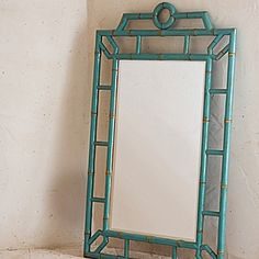 Turquoise bamboo mirror.  Serena and Lily. Would look great as a pair in a bathroom with a double vanity.