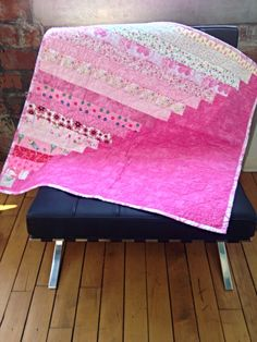 Quilt made of assorted pink fabrics with hand by StitchedIntoGear, $65.00