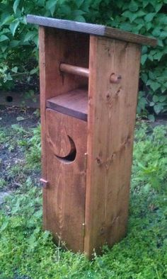 """Outhouse toilet paper holder. Holds four big rolls in the door and one on the roller. 26-1/2"""" tall. - handcrafted by TAMs DeSigns"""