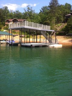 North Georgia Boat Lift & Marine Construction Company completed installation on this fantastic CAT 5 dock yesterday at Blue Ridge. Custom designed with an overhanging canopy to further protect and dock, this one has it all. Fitted with a single-slip combined with a wide side, this dock features Aluminum Sandstone decking. The upper level consists of a deck also sporting Aluminum Sandstone decking as well as Mocha railing and a 10 ft canopy. Overall a fantastic dock! Dock Ideas, Boat Lift, Boat House, Boat Dock, Blue Ridge, Canopy, Custom Design, Deck, Backyard
