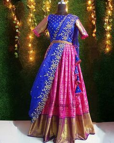 Pink and blue classic combination of kanchi look alike banaras silk lehenga paired with blue organza cutwork dupatta and a detachable lace belt. Wedding Saree Blouse Designs, Half Saree Designs, Pattu Saree Blouse Designs, Blouse Designs Silk, Lehenga Designs, Lehenga Saree Design, Half Saree Lehenga, Saree Look, Silk Lehenga
