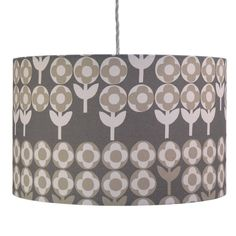 Our gorgeous Verdure lampshade features a subtle warm grey palette in a floral pattern designed in 1965.Available as a pendant shade to hang from the ceiling or to fit a floor or table lamp.Verdure is our brand new fabric with a fantastic heritage. Designed by Peter Hall in 1965, this design has long been a favourite of ours and we are delighted to be able to give it a new lease of life in three new colourways. The fabric is 100% heavyweight cotton printed in the UK. The lampshade is…