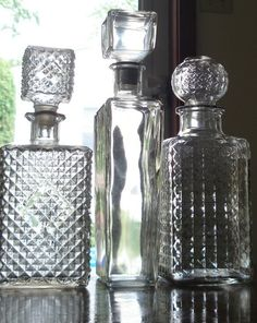 Set of 3 glass liquor decanters for your vintage bar. All have a lovely texture and a nice weight to them. Their common theme is the texture and the