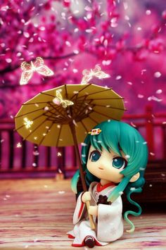 Nendoroid Miku Hatsune with a umbrella.