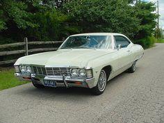 1967 Chevrolet Impala 2dr Hardtop, 195hp 283 V-8 , Automatic Powerglide Transmission, Power Steering, Tilt Steering Wheel, Rear Antenna, Dual Original Mirrors, Fender Skirts, Blue Interior, Ermine White Exterior