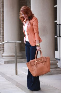 Simple and chic. casual fridays at the office. Love her bag and hair... and the shade of the blazer.