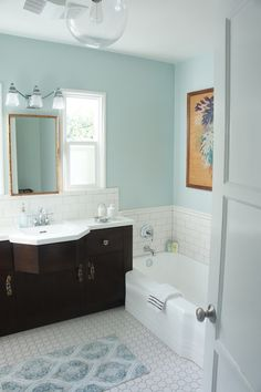 bathrooms - Dunn Edwards Cold water, bathroom, light blue, globe pendant, bamboo mirror,  Bathroom