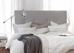 Gray headboard, white down comforter, side lamp, gray throw blanket. Love the neutral bedroom