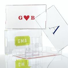 Graphic Rectangular Acrylic Tray.  Crafted from a single-piece of acrylic, these trays make a mark with an address, family name or bright and bold graphic design. The cutout handles further the style and functionality of these multipurpose trays. The UV-printed personalization offers a bolt of color to a clear classic.