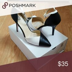 Black and white pointed toe heels Graphic black k and white, new never worn. Another event to go to from day to night? These will take you on a fun date! signature  Shoes Heels