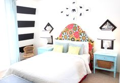 I LOVE this room! The one striped wall is gorgeous. This might be the new inspiration for my bedroom.