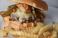 The Mindy Burger AKA Sriracha Cheeseburger. Pickled jalapeños, fried onion strings and homemade sriracha aioli pack a flavor punch.