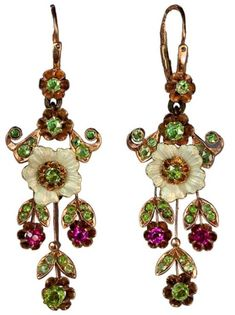 Russian Art Nouveau Enameled Demantoid Long Earrings Russia 1908-1917 These delicate vintage Russian pendant earrings were made in Moscow between 1908 and 1917.  Handcrafted in 14K rose gold, decorated with finely enameled pearl white flowers, and set with 44 Uralian demantoids and 4 synthetic rubies. Enameled Art Nouveau earrings are exceptionally rare and highly unusual. Length with wire ring - 2 in. ( 5cm); without wire ring - 11/2 in. (4cm) Both earrings are marked with ...