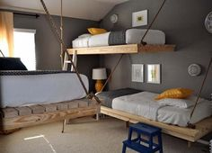 These simple and straightforward beds, suspended by rope, have an industrial vibe and a nice mixed use of materials.