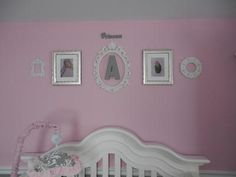An arrangement of wall decorations in a baby girl's pretty pink princess nursery: The pretty pink and gray princess nursery that we decorated for our baby girl nursery is a room that can grow with our baby from infancy through the toddler