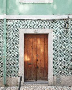 Wooden door along a green tiled wall in Lisbon Portugal with afternoon dappled sunlight. Entryway Art, Mint Walls, Exterior Tiles, Travel Wall Art, Facade Design, Wooden Doors, Architecture Details, Travel Photography, Art Tiles