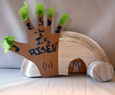 roll the stone away craft - Tell the story of Jesus and the tomb on Easter Sunday with this cool craft using kid hands ot make a tree and finger print to make an Angel.
