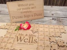 Instead of choosing the sregular wedding signature book, use puzzle pieces!!! Glue it and hang in a shadow box for