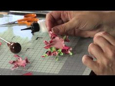 Karen Hayselden show how to make a Wreath with different paperflowers.