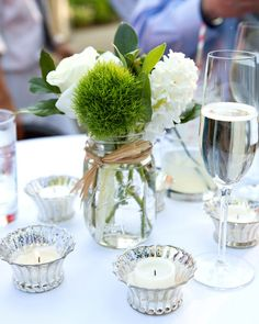 Green trick dianthus, white roses and greenery in mason jars  {Aida Krgin Photography}