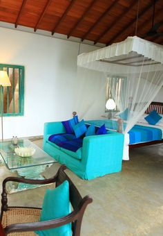 At The Last House, bright turquoise accents stand out against the polished concrete floors and traditional wooden furniture. Boutique Hotel Bedroom, Best Boutique Hotels, Wooden Furniture, Outdoor Furniture, Outdoor Decor, Turquoise Accents, Polished Concrete, Concrete Floors, Dream Bedroom
