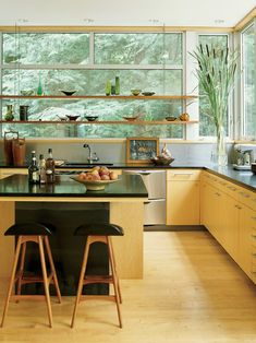 Modern Kitchen Design | Amy Lau Design | Shelving in front of kitchen window, suspended wood shelves, lovely kitchen finishes