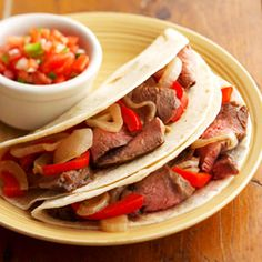 Flank steak, sweet peppers, and onions are flavored in a Tex-Mex marinade then broiled and served in tortillas for new family favorite.