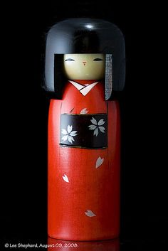 Kokeshi dolls are Japanese in origin and hand made, turned from wood before being decorated in bright colours.