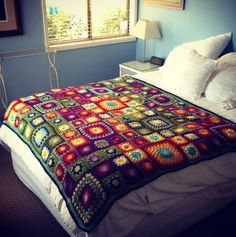 Bedspread. Terrific colors and I love the different square sizes.