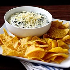 Easy Slow-Cooker Spinach and Artichoke Dip--You don't have to fuss over appetizers at your next get-together when you make this dip. Literally throw everything needed in a slow-cooker, step away, and let it do all of the hard work. When this deliciously creamy and cheesy dip is finished, pour it into a serving bowl or keep it warm by serving it directly from the slow-cooker.