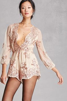 44c680d5afe7b8 A sheer mesh knit romper with a nude lining by Reverse™ featuring a sequin  design