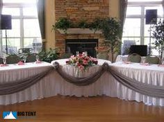 Love this sort of angled head table with a sweet heart table in the center!