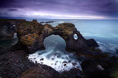 Coastal rock arch in Iceland.