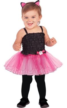 Meow! Let your baby take the stage in this adorable cat costume! Our Baby Ballerina Cat Costume includes a black and pink spaghetti strap stretch dress with a layered tutu skirt and pink bow accent. A matching cat ears headpiece adds an adorable finishing touch to this affordable cat costume for babies.  Baby Ballerina Cat Costume includes:    Headpiece  Tutu dress