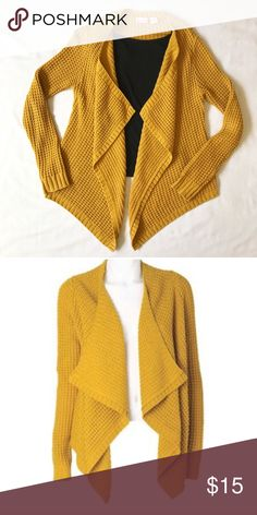 "🆕 Mustard popcorn knit cardigan This piece never ceases to receive compliments! A draping front, a trendy knit pattern, and a golden mustard color that pops. Open front, no closures. Size small, but will also fit a medium. Front: 31"". Back: 22.5"". EUC--some very slight pilling, but barely worth mentioning. ❣Make an offer!❣❌No trades!❌ ALLOY Sweaters Cardigans"