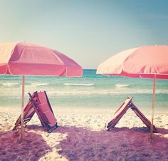Pink umbrellas at the beach