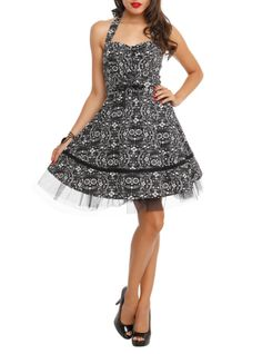 Halter dress with The Book of Life inspired inspired print design, lace-up front detail, black lace trim and lined skirt with tulle accent.