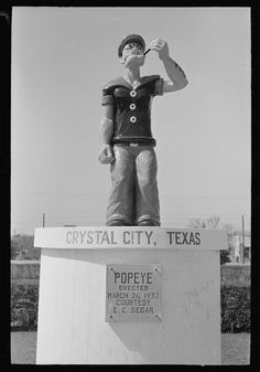 [Untitled photo, possibly related to: Monument erected to Popeye, Crystal City, Texas. This is in the spinach growing center] Lee, Russell. Library Of Congress, Texas, Baseball Cards, City, Spinach, Movie Posters, Crystal, Historia, Film Poster