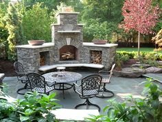 Outdoor Fireplace    Would love for my dad to brick me one.