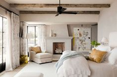 Cozy master bedroom with fireplace. love the herringbone brick in the fireplace, wood beams on the ceiling, and chaise lounge