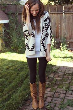 White and black Aztec cardigan, black leggings, tan boots