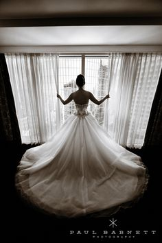 Dramatic black-and-white photos of the back of the bride's wedding dress.