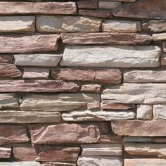 Stone can add a natural feel to an existing stucco wall.