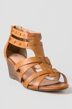 The DeluxDemi-Wedge Sandalare youreveryday shoe.Awoven vamp, cupped heel,back zipper and a a low wedge combine to create this goddess of a sandal