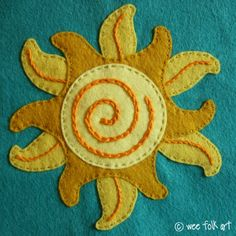 I'd love to use this sun for a summer dress or summer place mats! - free applique block pattern from WeeFolkArt