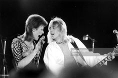 David Bowie (1947 - 2016, left) performing with guitarist Mick Ronson (1946 1993) at a live recording of 'The 1980 Floor Show' for the NBC 'Midnight Special' TV show, at The Marquee Club in London, with a specially invited audience of Bowie fanclub members, 20th October 1973.